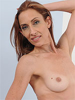 Gorgeous 43 year old redheaded Betty Blaze performing naked ballet
