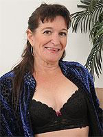 50 year old Anna D breaks from foling laundry to put on a show here