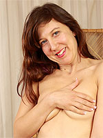 Hairy pussied Valentine from AllOver30 slips on her slil stockings