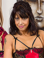 47 year old brunette MILF Sophia Smith spreading her mature pussy